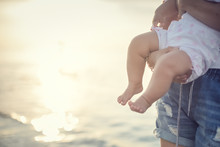 Mother And Baby At Sunset On The Beach