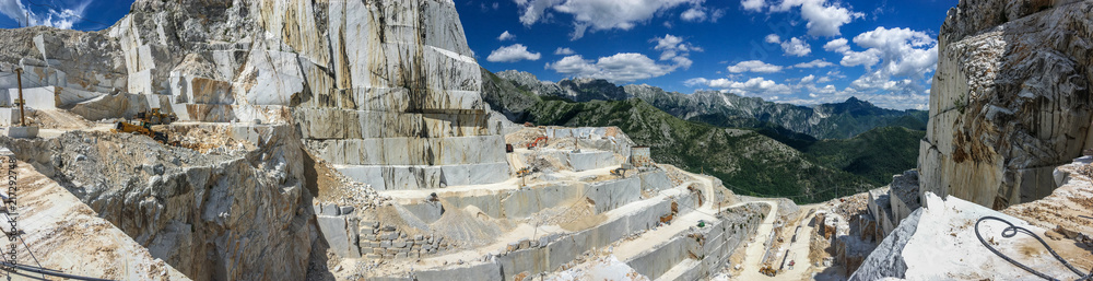 Fototapeta High stone mountain and marble quarries in the Apennines in Tuscany,  Carrara Italy. Open marble mining.