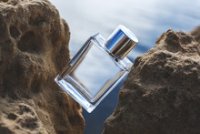 Perfume Bottle Located On The Rocks In The Sunlight