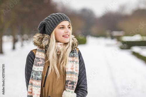 Portrait of smiling teenage girl in winter