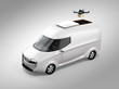 Delivery drone takeoff from white electric delivery van on gray background. Copy space on the body. 3D rendering image.