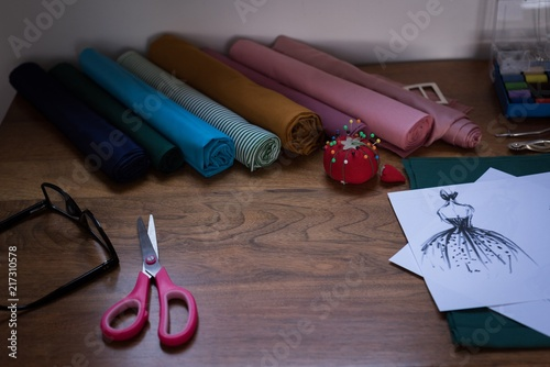 Fabric and design sketch on table