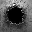 Dark cracked broken hole in concrete wall. Grunge background