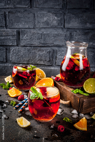 Carta da parati Summer cold cocktail, fruit and berry red wine sangria with apple, lemon, oranges and raspberry