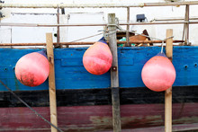 Side Of Fishing Boat With Buoys