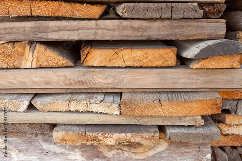 Foto op Canvas Brandhout textuur pile of old firewood for background