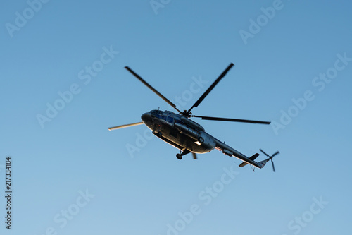 helicopter in the air against the blue sky