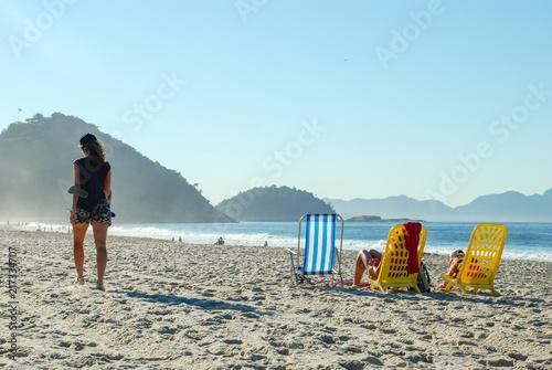 Deurstickers Centraal-Amerika Landen Woman walking on the beach of Copacabana, Rio de Janeiro