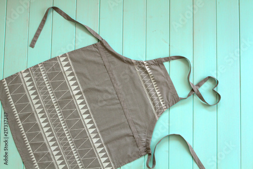 Carta da parati apron kitchen for cooking a gray color lies on the table