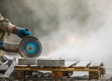 Grinder Worker Cuts A Stone Th...