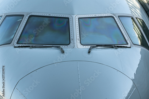Fotografia  Close up of a jet airplane cockpit Front view of the airplane window with windshield wipers