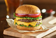 canvas print picture double cheeseburger with lettuce, tomato, onion, and melted american cheese