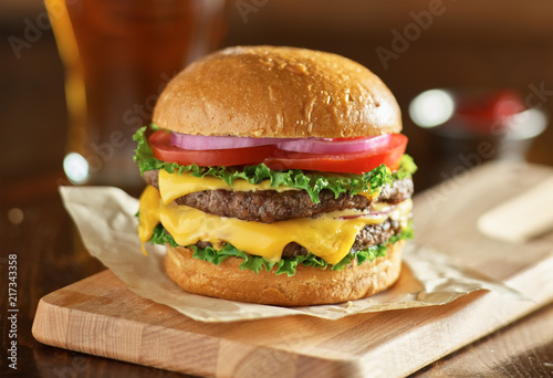 double cheeseburger with lettuce, tomato, onion, and melted american cheese