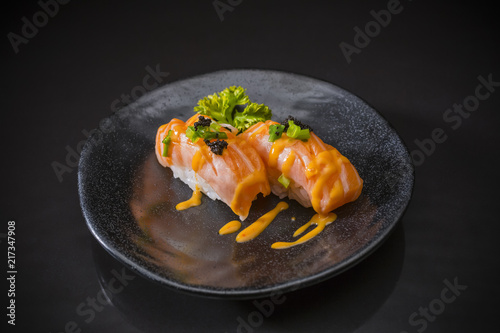 Staande foto Klaar gerecht Salmon Nigiri, Sushi salmon burned and topped with Shrimp Eggs, served on traditional Japanese food on ceramic dish, Japanese food style, Japanese Food menu, selective focus