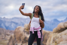 Fit African American Woman Taking Selfie At Alabama Hills Park In California During Hike