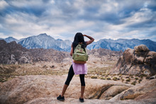 Rear View Of Woman Hiking At A...