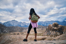 African American Woman Stopping To Look At Impressive View During Hike At Alabama Hills Park California