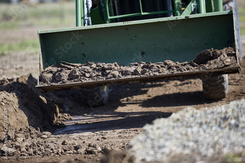 Tractor Bucket moving Dirt - Buy this stock photo and