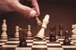 Leinwandbild Motiv Businessman playing chess close up
