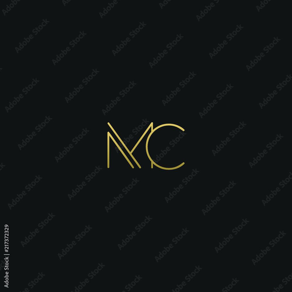 Fototapeta Creative modern elegant MC black and gold color initial based letter icon logo.