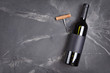 Flat lay of lying wine bottle with black empty label for tasting and copy space