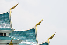 Small Finials Jutting Out Of The Side – Corners Of The Blue Gable Roof, Representing The Heads Of Naga. This Unique Blue Tiles Roof Is Wat Pha Phu Gon Temple's Roof