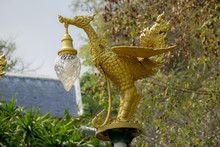 Bronze Casting Thai Literature Swans Carrying Bell-shaped Electricity Lantern Painted With Gold Colour Located In The Wat Pha Phu Gon Temple's Garden.
