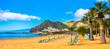 canvas print picture Amazing view of beach las Teresitas with yellow sand, umbrellas, longues and palm trees. Location: Santa Cruz de Tenerife, Tenerife, Canary Islands. Panorama