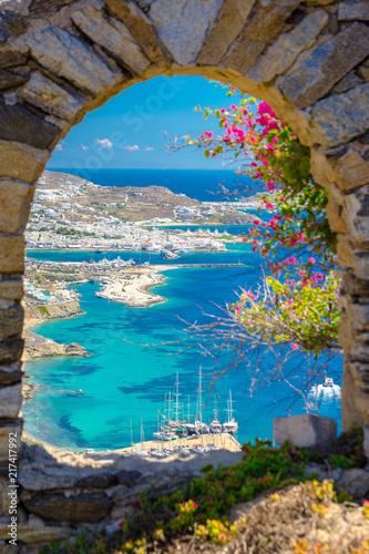 Fototapeta Mykonos port with boats and windmills, Cyclades islands, Greece obraz