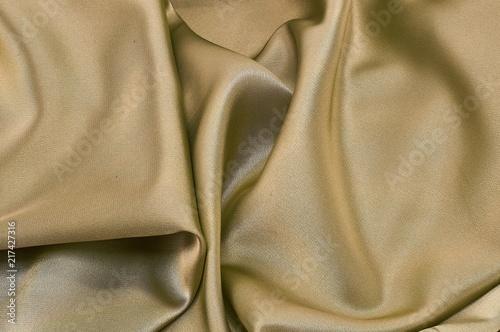 Fotobehang Stof silk fabric yellow