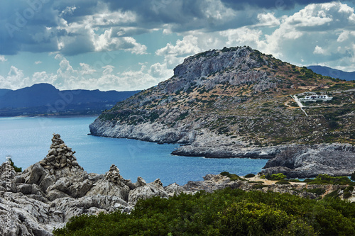 Fotografie, Obraz  rocky cliff at the edge of the Mediterranean Sea, on the island of Rhodes