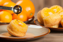 Homebaked Upside Down Clementine Muffins. Maple Syrup Pour On.