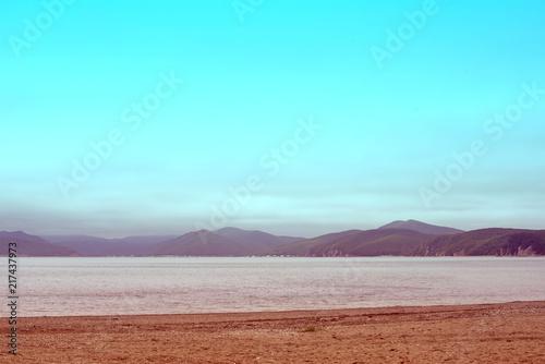 Spoed Foto op Canvas Turkoois seascape morning dawn horizon sea coast Bay hill sea pebble autumn.