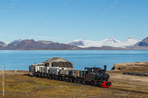 Deurstickers Poolcirkel old industrial train in Ny Alesund, Spitzbergen, Svalbard, blue sky