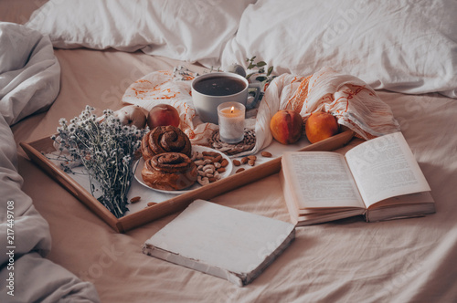 Breakfast in bed, a tray of tea, croissants, fruit, flowers Canvas Print
