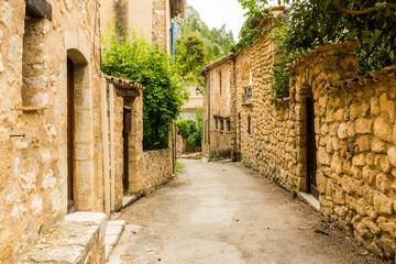 FototapetaOld medieval street with old houses of charming village Moustiers Sainte Marie, Verdon, Provence in France