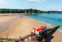 A Huge, Empty Sandy Beach At Low Tide On A Clear, Sunny Day (Tenby, Wales)