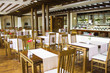 Cozy cafe with a buffet with wooden tables and chairs