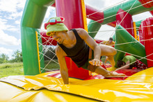 Man Jumping On Colorful Playgr...