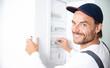 canvas print picture - Elektriker arbeitet an einem Sicherungskasten, Elektroinstallation