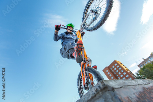 Fotografie, Obraz  professional BMX rider made tricks on bicycle