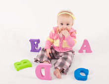 Baby Playing  With Alphabet Letters