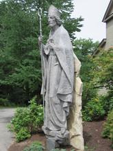 A Stone Statue Of Saint Patric...