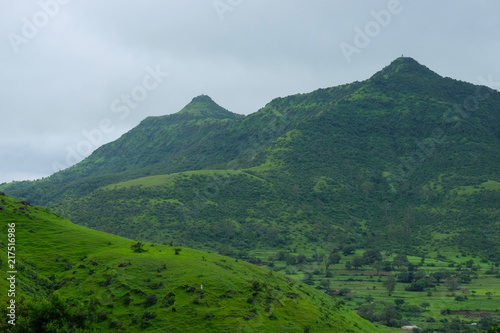 Spoed Foto op Canvas Bleke violet Lush green monsoon nature landscape mountains, hills, farming plot, Purandar, Pune, Maharashtra, India