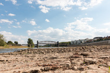 Magdeburg, Germany - August 10, 2018: View Of The Dry Riverbed Of The Elbe In Magdeburg With The Lift Bridge Hubbrücke In The Background. Drought. Climate Change.