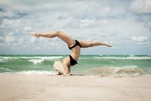 Gymnast On The Sea Beach