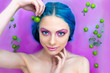 Portrait of sexy young woman female girl / fashion luxury model with blue hair relaxing in bathtub with plants and pink water. Organic skin care, beauty and body care concept. Spring coming.