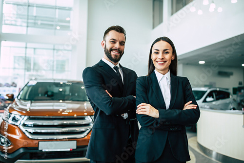 Cuadros en Lienzo Confident salesteam in dealership, two  beautiful consultants or managers in bla
