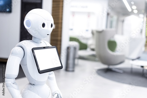 Leinwand Poster Welcoming electronic cyborg robot with white tab screen