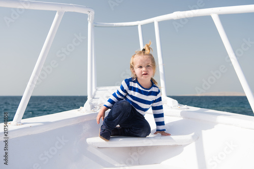 Childhood concept. Little child enjoy sea travel on ship, childhood. Joys of childhood. Childhood experience. Summer vacation and adventure